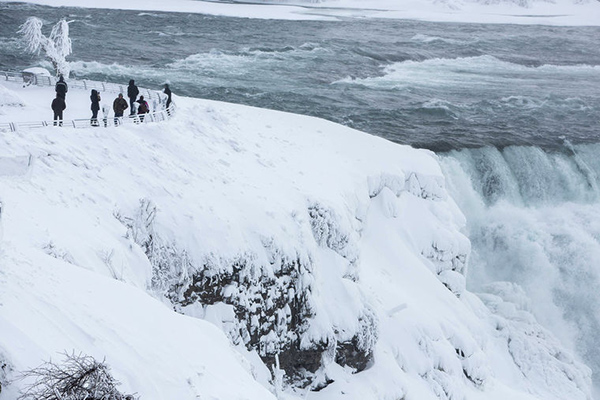 Image: Visitors view Niagara Falls in sub freezing temperatures in Niagara Falls New York